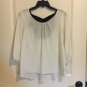 White Blouse w/ Black Bow in Back
